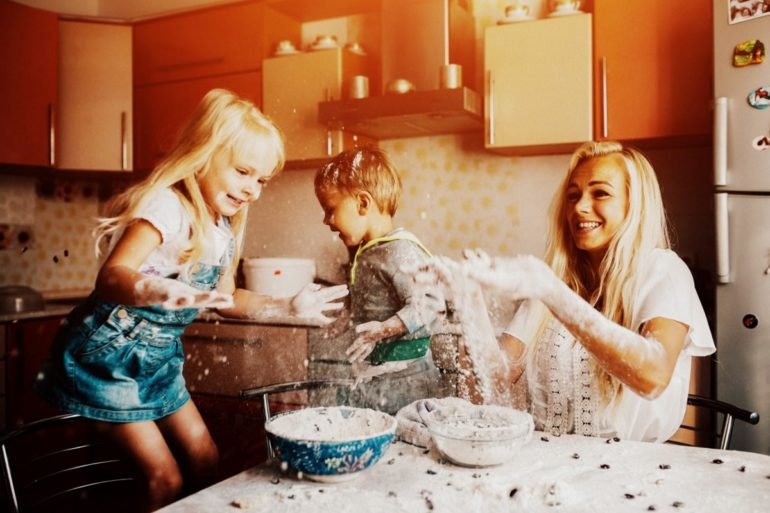 Mother in kitchen with kids